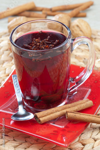 Glass of mulled wine with spoon and cinnamon
