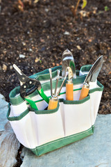 Detail of gardening tools in tool bag - outdoor.