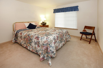 Bedroom with simple bed and stool