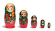 Red russian nesting dolls in line