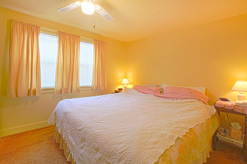 Yellow bedroom with simple bed