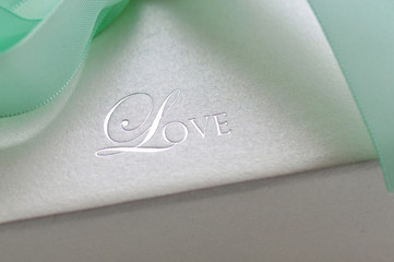 Picture of embossing love word with ribbons