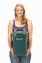 Young woman holding recycling container