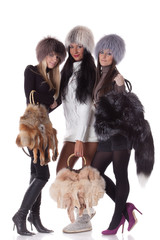 Young women in fur with bags.