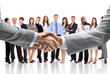 Leinwanddruck Bild - handshake isolated on business background