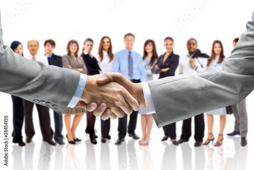 Leinwanddruck Bild handshake isolated on business background