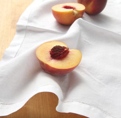 fresh peaches on a napkin