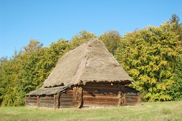 Ancient traditional carpatian cottage with a straw roof