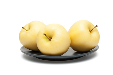 yellow apples on plate