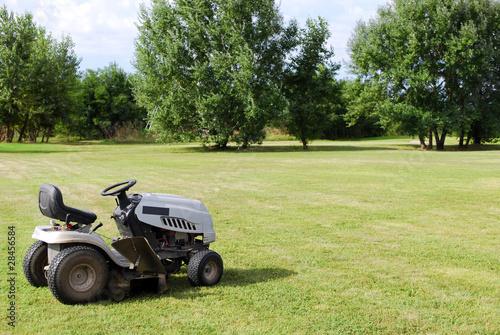 lawn mower on field - 28456584