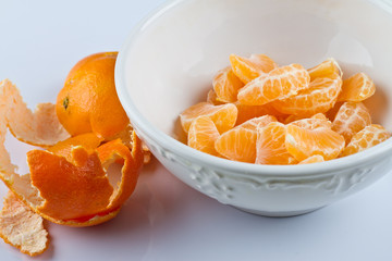 Peeled clementines in bowl