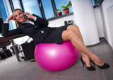woman in office on pilates ball