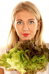 Young Woman Holding a Lettuce. Model Released