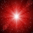 Abstract red background of luminous rays and stars.