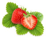 Isolated strawberries. Two strawberries, one cut in half over green leaves isolated on white background