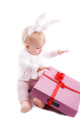 Baby in rabbit costume with pink gift