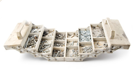 Plastic box with various bolts and nuts, isolated on white