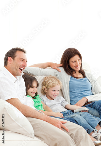Happy family watching a movie together