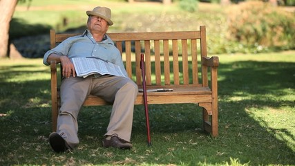 Old man sleeping on a bench