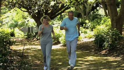 Elverly couple running together