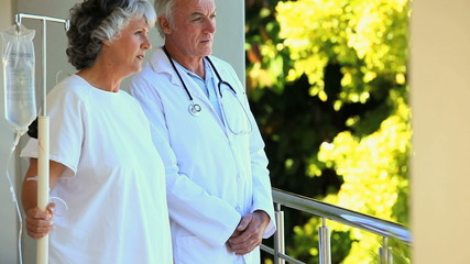 Doctor talking with his patient on the deck