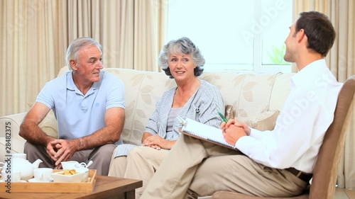 Old couple talking with a commercial