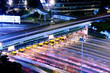 Quadro blurred bus light trails in downtown night-scape
