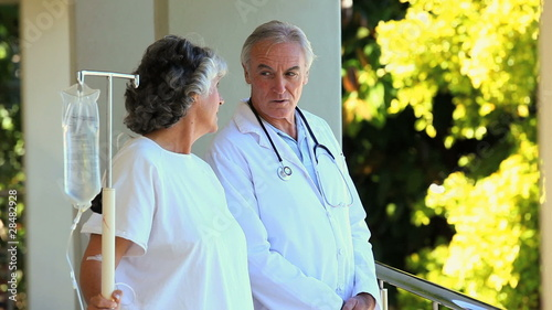 Doctor and his patient walking