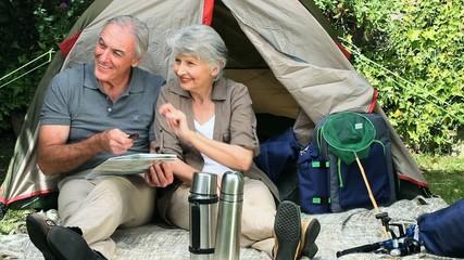 Seniors sitting near a tent