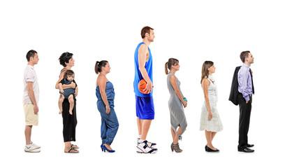 Full length portrait of different men and women standing