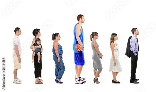 Full length portrait of different men and women standing - 28484589