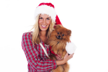Young woman and her Pomeranian on christmas