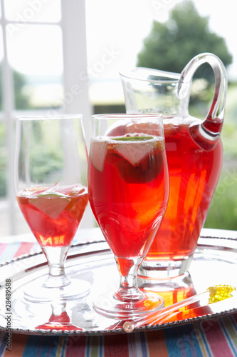 Fruit drink in a decanter and glasses.