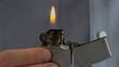 Close up of man lighting a lighter