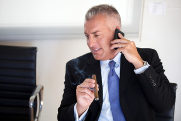 Businessman smoking a cigar