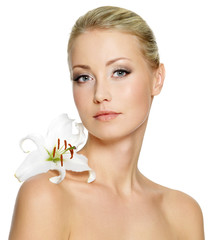 Beautiful woman with  clean skin and white flower