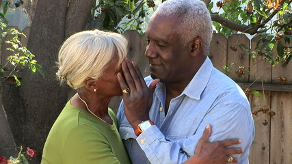 Close up portrait of senior couple outdoors