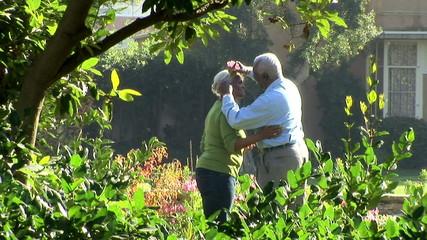 Senior couple outdoors in garden