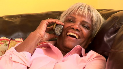 Portrait of senior woman at home on the cell phone