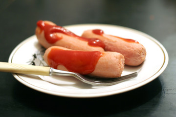 hot dog and ketchup on light plate