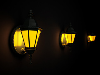 Shone street lanterns on a wall at dark night
