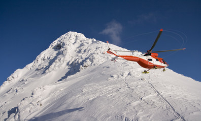 Helicopter mountain rescue service in the winter.
