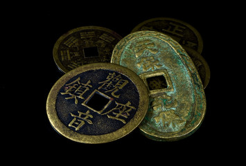 Chinese coins on black