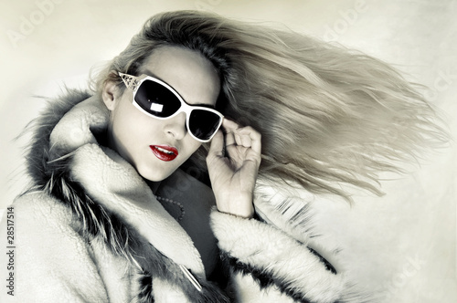 Fashion woman with developing hair