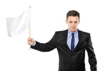 A sad man holding a white flag, gesturing defeat