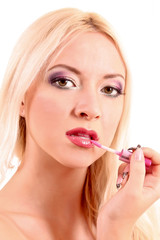 Young beautiful blond woman with pink lipstick isolated on white