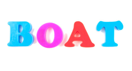 boat written in fridge magnets isolated on white