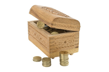 Wooden casket with coins on white background