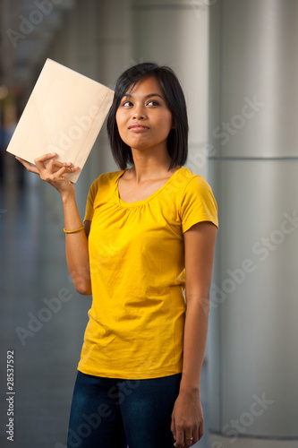 Pensive College Student Book Held High