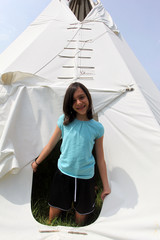 young girl in a tepee